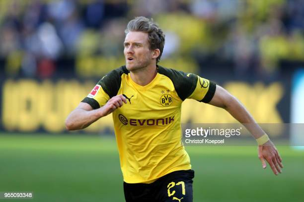 Andre Schuerrle of Dortmund runs with the ball during the Bundesliga match between Borussia Dortmund and 1 FSV Mainz 05 at Signal Iduna Park on May 5...