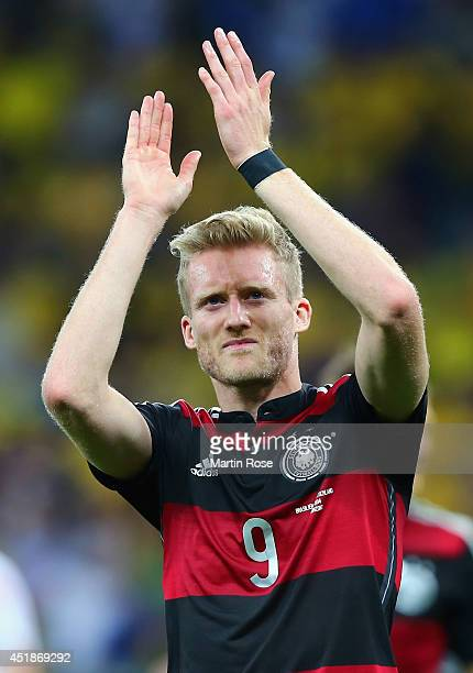 Andre Schuerrle of Germany acknowledges the fans after defeating Brazil 71 during the 2014 FIFA World Cup Brazil Semi Final match between Brazil and...