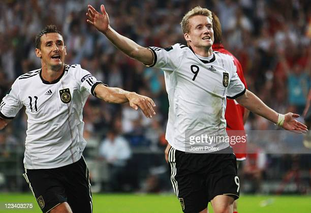 Andre Schuerrle of Germany celebrates after scoring his team's fifth goal during the UEFA EURO 2012 qualifying match between Germany and Austria at...