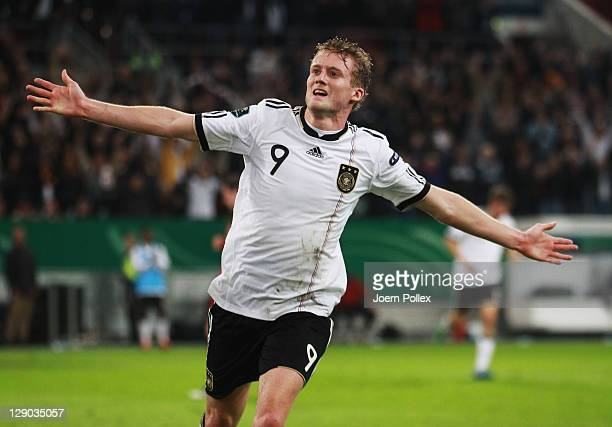 Andre Schuerrle of Germany celebrates after scoring his team's second goal during the UEFA EURO 2012 Group A qualifying match between Germany and...