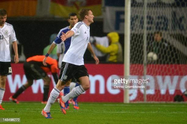 Andre Schuerrle of Germany celebrates after scoring his team's second goal during the International friendly match between Germany and Israel at...