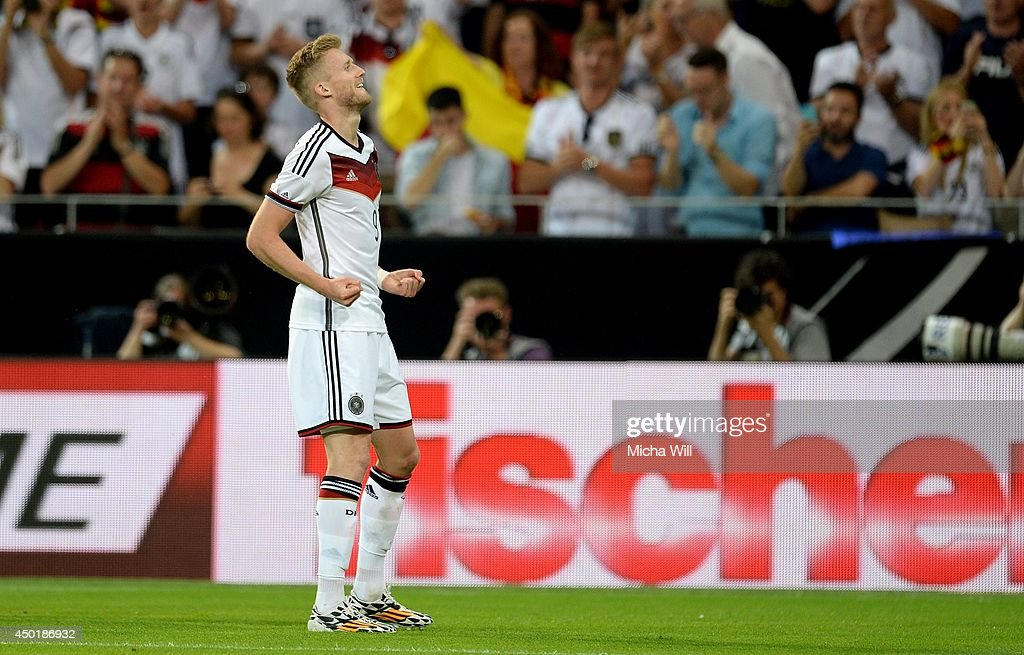 Andre Schuerrle of Germany celebrates after scoring the opening/first goal during the international friendly match between Germany and Armenia at Coface Arena on June 6, 2014 in Mainz, Germany.