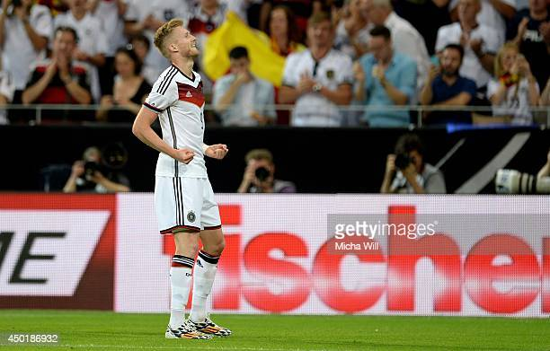 Andre Schuerrle of Germany celebrates after scoring the opening/first goal during the international friendly match between Germany and Armenia at...