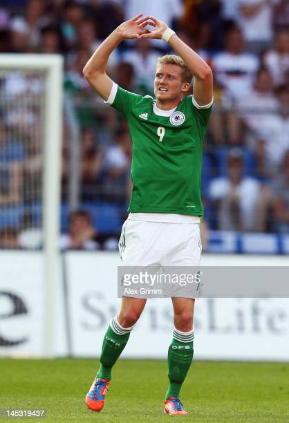 Andre Schuerrle of Germany celebrates his team's second goal during the international friendly match between Switzerland and Germany at St JakobPark...