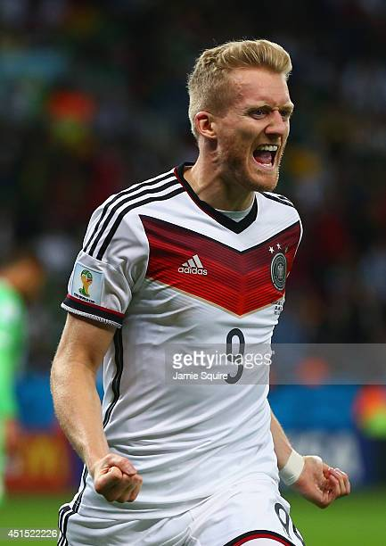 Andre Schuerrle of Germany celebrates scoring his team's first goal in extra time during the 2014 FIFA World Cup Brazil Round of 16 match between...