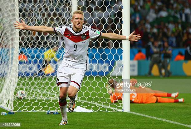 Andre Schuerrle of Germany celebrates scoring his team's first goal past goalkeeper Rais M'Bolhi of Algeria during the 2014 FIFA World Cup Brazil...