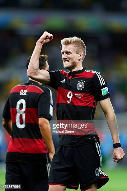 Andre Schuerrle of Germany celebrates scoring his team's seventh goal and his second of the game during the 2014 FIFA World Cup Brazil Semi Final...