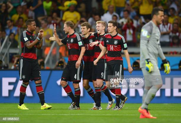 Andre Schuerrle of Germany celebrates scoring his team's seventh goal with his teammates Jerome Boateng , Benedikt Hoewedes , Thomas Mueller and...