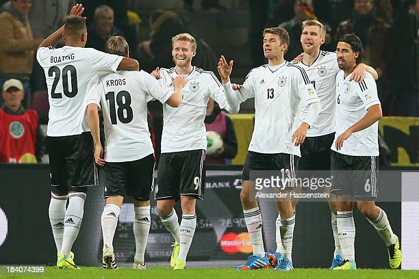 Andre Schuerrle of Germany celebrates scoring the second team goal with his team mates Jerome Boateng Toni Kroos Thomas Mueller Per Mertesacker and...