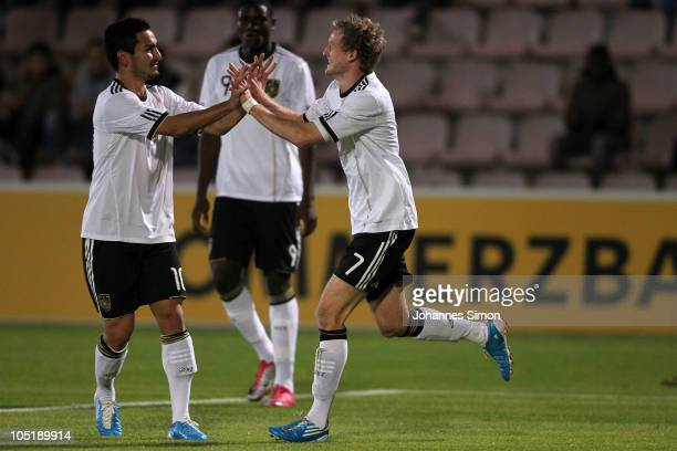 Andre Schuerrle of Germany celebrates with team mate Ilkay Guendogan and Peniel Mlapa after scoring 10 during the U21 international friendly match...