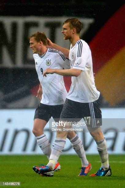 Andre Schuerrle of Germany celebrates with teammate Per Mertesacker after scoring his team's second goal during the International friendly match...