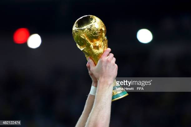 Andre Schuerrle of Germany holds up the World Cup trophy after the 2014 FIFA World Cup Brazil Final match between Germany and Argentina at Maracana...