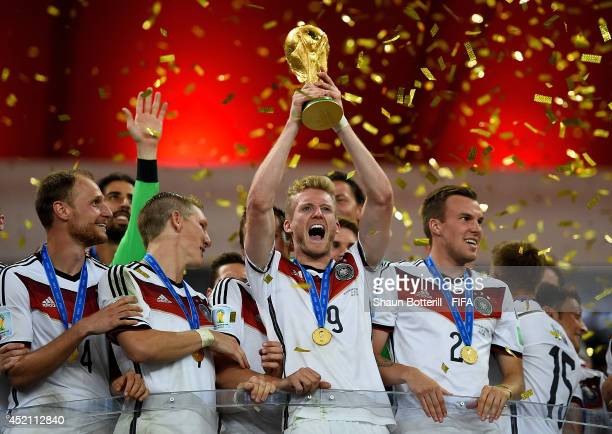 Andre Schuerrle of Germany lifts the World Cup to celebrate with his teammates during the award ceremony after the 2014 FIFA World Cup Brazil Final...