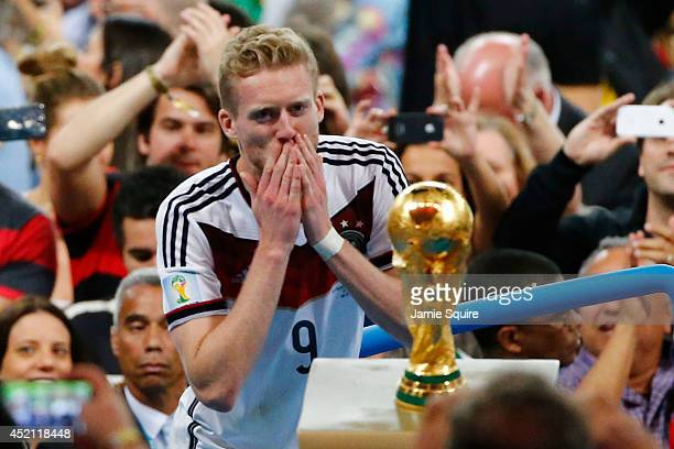 Andre Schuerrle of Germany looks at the World Cup trophy after defeating Argentina 1-0 in extra time during the 2014 FIFA World Cup Brazil Final...