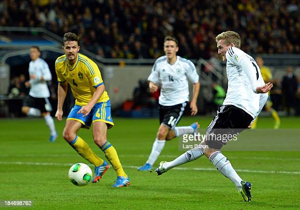 Andre Schuerrle of Germany scores his teams fourth goal during the FIFA 2014 World Cup Qualifying Group C match between Sweden and Germany at Friends...