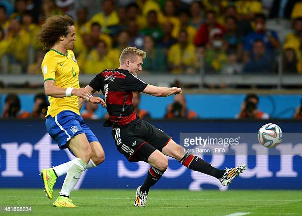 Andre Schuerrle of Germany scores his team's seventh goal during the 2014 FIFA World Cup Brazil Semi Final match between Brazil and Germany at...