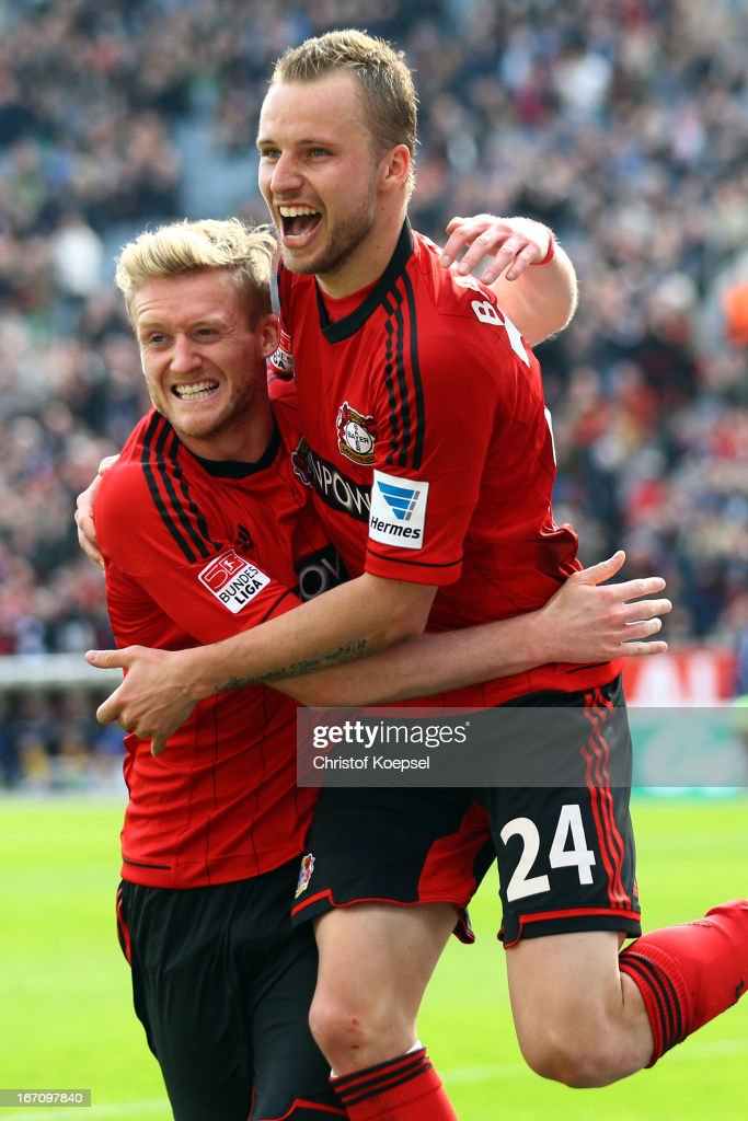 Andre Schuerrle of Leverkusen celebrates the forth goal with Michal Kadlec during the Bundesliga match between Bayer 04 Leverkusen and TSG 1899 Hoffenheim at BayArena on April 20, 2013 in Leverkusen, Germany.