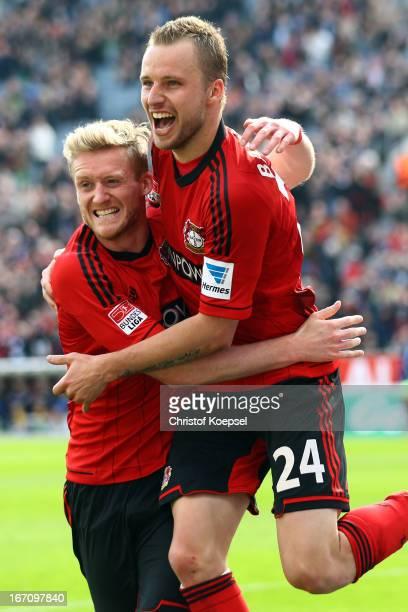 Andre Schuerrle of Leverkusen celebrates the forth goal with Michal Kadlec during the Bundesliga match between Bayer 04 Leverkusen and TSG 1899...