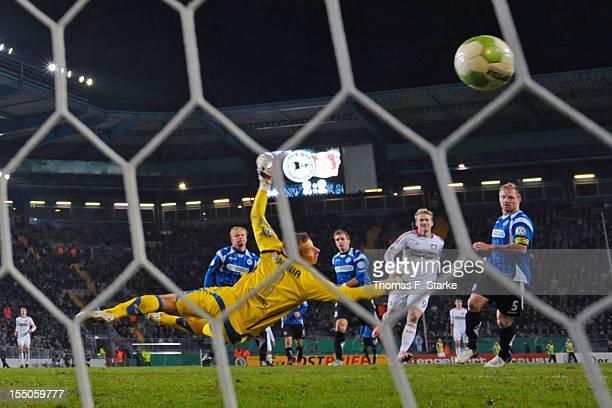 Andre Schuerrle of Leverkusen scores the final goal against Manuel Hornig Patrick Platins Tom Schuetz and Thomas Huebener vof Bielefeld during the...