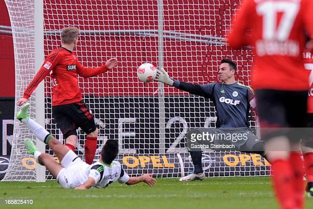 Andre Schuerrle of Leverkusen scores the opening goal during the Bundesliga match between Bayer 04 Leverkusen and VfL Wolfsburg at BayArena on April...