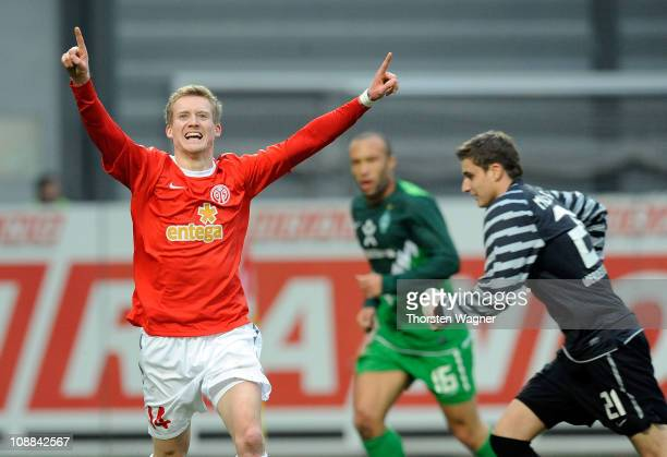 Andre Schuerrle of Mainz celebrates after scoring his team's first goal during the Bundesliga match between FSV Mainz 05 and SV Werder Bremen at...