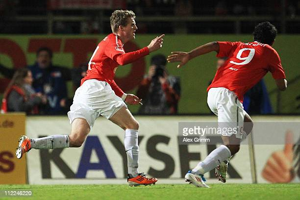 Andre Schuerrle of Mainz celebrates his team's first goal with team mate Sami Allagui during the Bundesliga match between FSV Mainz 05 and Borussia...