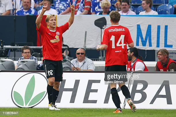 Andre Schuerrle of Mainz celebrates his team's first goal with team mate Lewis Holtby during the Bundesliga match between FC Schalke 04 and FSV Mainz...