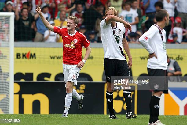 Andre Schuerrle of Mainz celebrates his team's second goal as he walks past Martin Amedick and Christian Tiffert of Kaiserslautern during the...