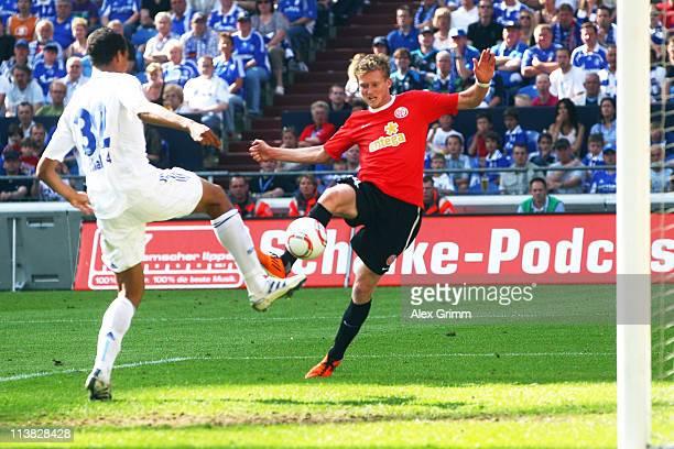 Andre Schuerrle of Mainz scores his team's first goal against Joel Matip of Schalke during the Bundesliga match between FC Schalke 04 and FSV Mainz...