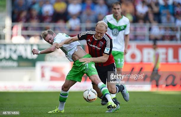 Andre Schuerrle of Wolfsburg and Tobias Levels of Ingolstadt tussle for the ball during the Bundesliga match between FC Ingolstadt and VfL Wolfsburg...