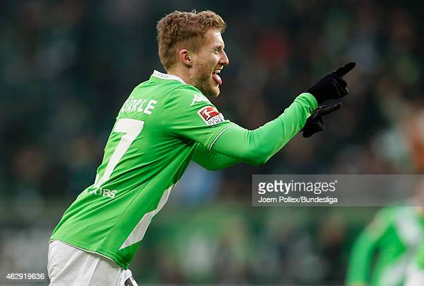 Andre Schuerrle of Wolfsburg celebrates after his team mate Kevin De Bruyne scored his Team's second goal during the Bundesliga match between VfL...