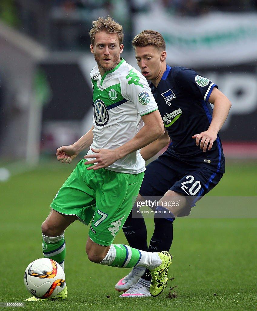 Andre Schuerrle (L) of Wolfsburg vies with Mitchell Weiser of Berlin during the Bundesliga match between VfL Wolfsburg and Hertha BSC at Volkswagen Arena on September 19, 2015 in Wolfsburg, Germany.