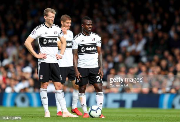 Andre Schurrle and Jean Michael Seri of Fulham during the Premier League match between Fulham FC and Arsenal FC at Craven Cottage on October 7 2018...