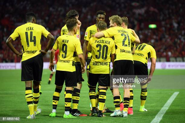 Andre Schurrle of Borussia Dortmund celebrates with his team mates after scoring a goal during the preseason friendly match between Urawa Red...