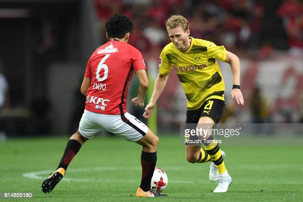 Andre Schurrle of Borussia Dortmund runs with the ball during the preseason friendly match between Urawa Red Diamonds and Borussia Dortmund at...