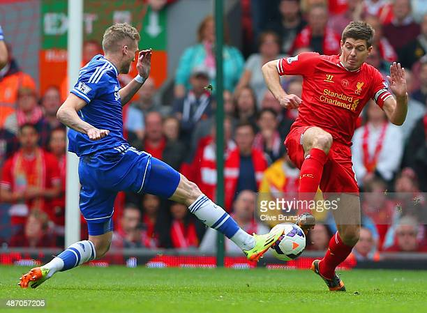 Andre Schurrle of Chelsea and Steven Gerrard of Liverpool battle for the ball during the Barclays Premier League match between Liverpool and Chelsea...