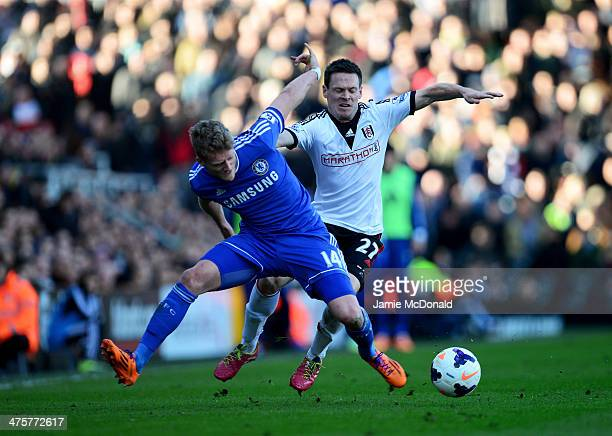 Andre Schurrle of Chelsea battles with Sascha Riether of Fulham during the Barclays Premier League match between Fulham and Chelsea at Craven Cottage...
