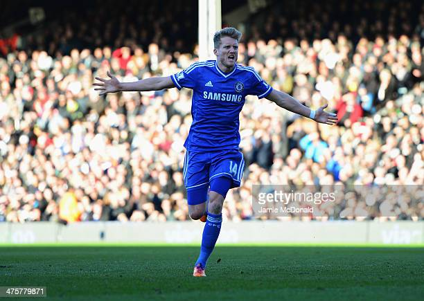 Andre Schurrle of Chelsea celebrates as he scores their first goal during the Barclays Premier League match between Fulham and Chelsea at Craven...