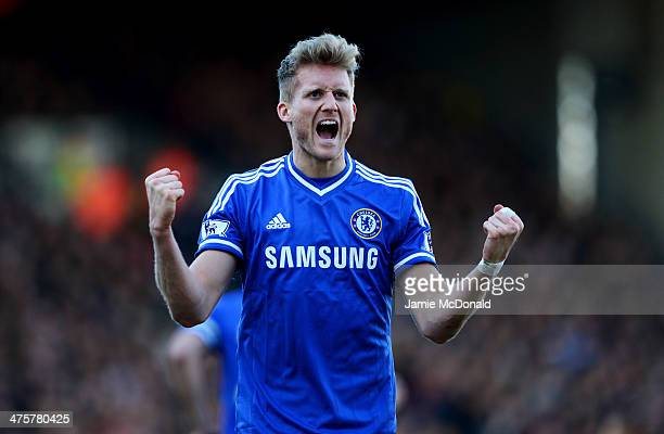 Andre Schurrle of Chelsea celebrates as he scores their second goal during the Barclays Premier League match between Fulham and Chelsea at Craven...