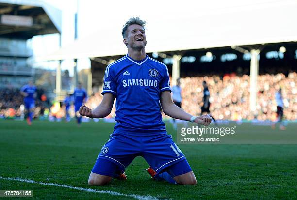 Andre Schurrle of Chelsea celebrates as he scores their third goal and completes his hat trick during the Barclays Premier League match between...