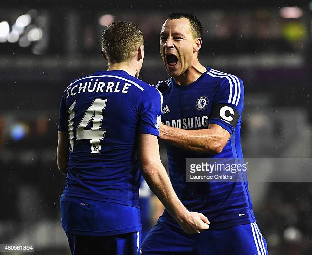 Andre Schurrle of Chelsea celebrates his goal with John Terry of Chelsea during the Capital One Cup QuarterFinal match between Derby County and...