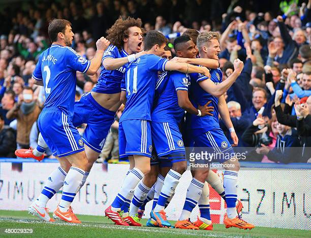 Andre Schurrle of Chelsea celebrates scoring his second goal with Nemanja Matic Eden Hazard David Luiz Samuel Eto'o Oscar Branislav Ivanovic of...