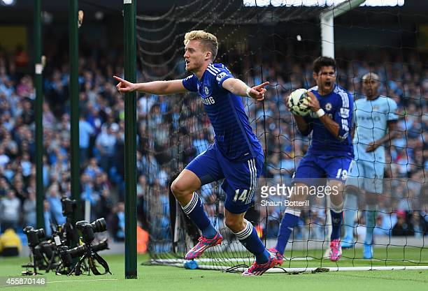 Andre Schurrle of Chelsea celebrates scoring the first goal during the Barclays Premier League match between Manchester City and Chelsea at the...