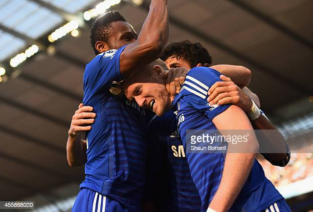 Andre Schurrle of Chelsea celebrates scoring the first goal with his teammates during the Barclays Premier League match between Manchester City and...