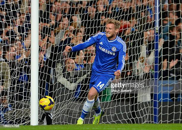 Andre Schurrle of Chelsea celebrates scoring their first goal during the Barclays Premier League match between Chelsea and Manchester City at...