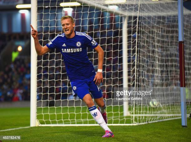 Andre Schurrle of Chelsea celebrates scoring their second goal during the Barclays Premier League match between Burnley and Chelsea at Turf Moor on...