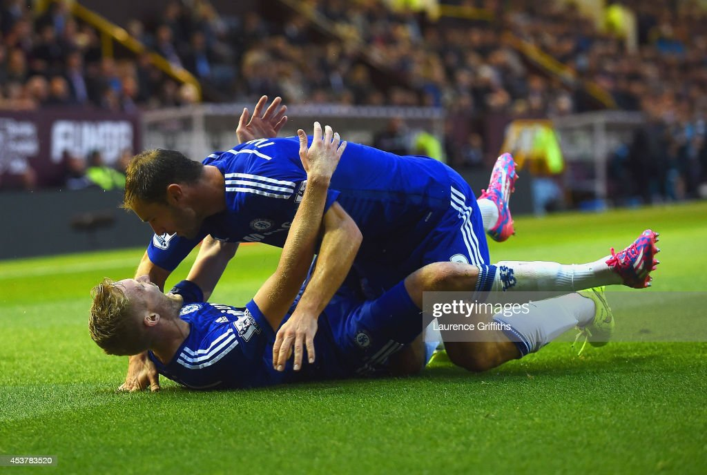 Andre Schurrle of Chelsea celebrates scoring their second goal with Branislav Ivanovic of Chelsea during the Barclays Premier League match between Burnley and Chelsea at Turf Moor on August 18, 2014 in Burnley, England.