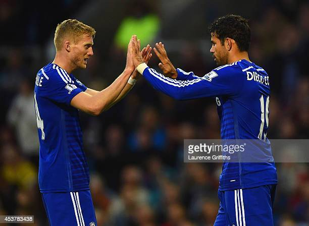 Andre Schurrle of Chelsea congratulates Diego Costa of Chelsea on scoring their first goal during the Barclays Premier League match between Burnley...