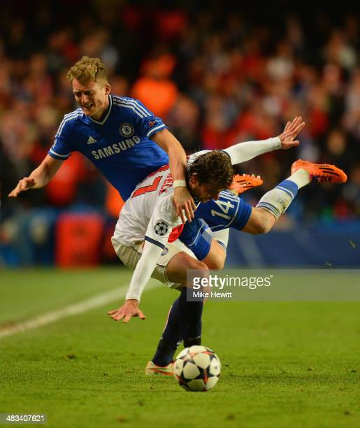 Andre Schurrle of Chelsea is fouled by Maxwell of PSG during the UEFA Champions League Quarter Final second leg match between Chelsea and Paris...