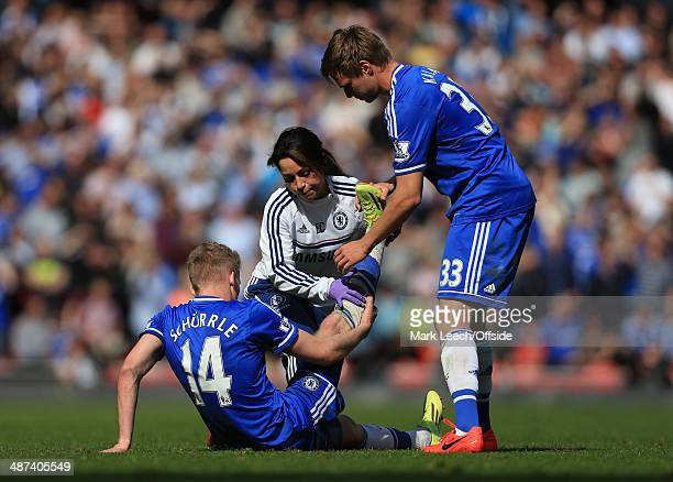 Andre Schurrle of Chelsea receives help with his cramp from Chelsea physio Eva Carneiro and teammate Tomas Kalas during the Barclays Premier League...